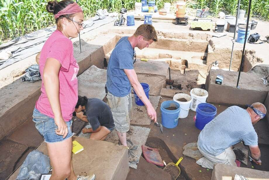 Indiana University student Ashley Brown looks on as professor of anthropology Jeremy Wilson points out measurements that need to be taken at an archaeological site in Cass County. Photo: Nick Draper   Journal-Courier