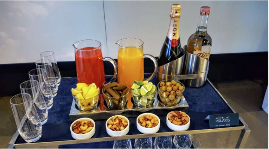 Bloody Mary cart in United Polaris business class will soon be eliminated- buy you can still get a bloody mary! Photo: Scott Hintz