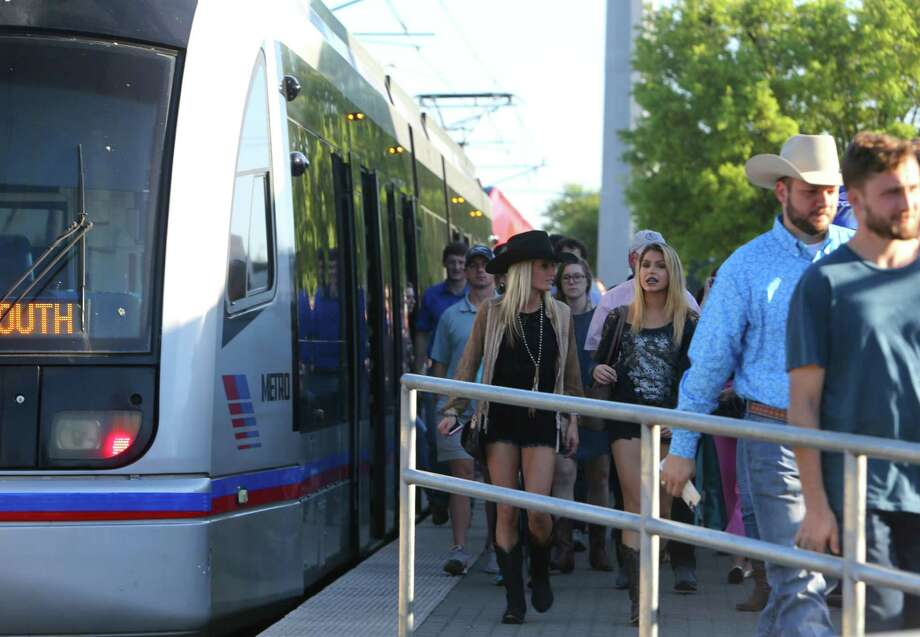 Visitors to the the Houston Livestock Show and Rodeo disembark the Metro light rail train along Fannin Street, Tuesday, March 21, 2017. Photo: Mark Mulligan, Staff Photographer / 2017 Mark Mulligan / Houston Chronicle