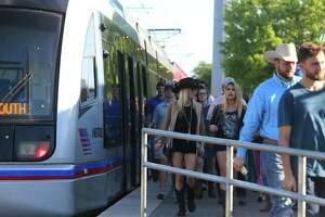 Visitors to the the Houston Livestock Show and Rodeo disembark the Metro light rail train along Fannin Street, Tuesday, March 21, 2017, in Houston. (Mark Mulligan / Houston Chronicle)