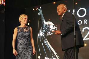 HOUSTON, TX - FEBRUARY 08:  Vera Pauw (L) and George Foreman speak during the Houston Sports Awards on February 8, 2018 in Houston, Texas.