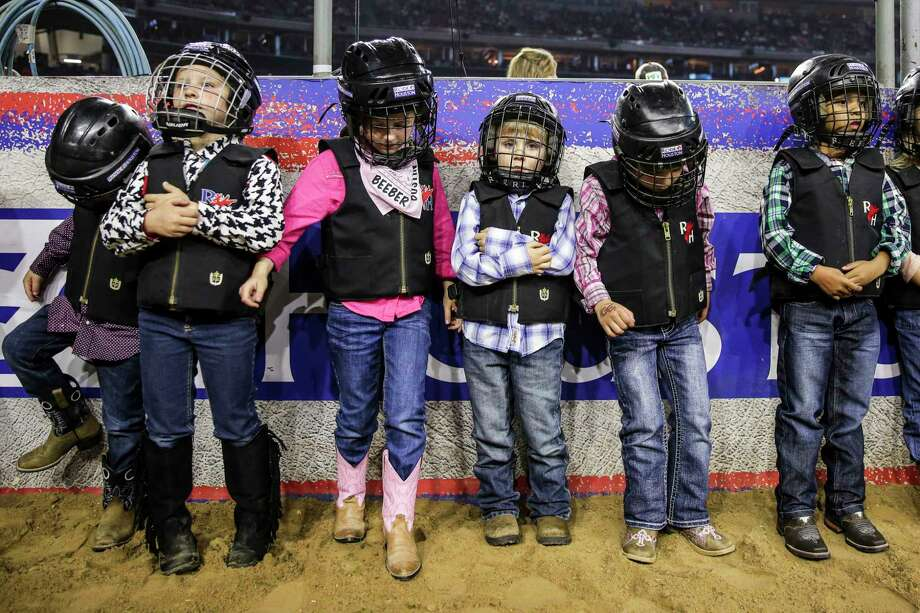 Kids line up as they prepare to compete in the mutton bustin' event during round three of Super Series V at the Houston Livestock Show and Rodeo Tuesday, March 21, 2017 in Houston. ( Michael Ciaglo / Houston Chronicle ) Photo: Michael Ciaglo, Staff / Michael Ciaglo
