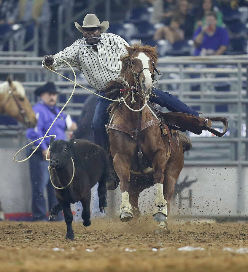 Fred Whitfield ropes a steer in the tie-down roping competition during RodeoHouston's Super Series II last year. Photo: Karen Warren, Staff Photographer / 2017 Houston Chronicle