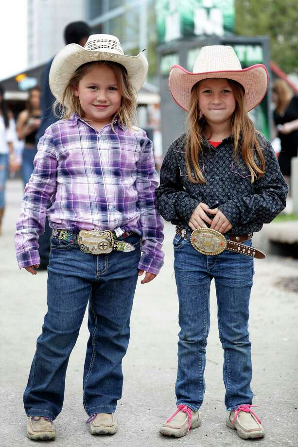 Don't forget Go Texan Day Friday, Feb. 23. Twins Bailey and Rylie Hebert show off their belt buckles and cowboy hats at last year's Houston Livestock Show & Rodeo. Photo: Karen Warren, Staff Photographer / 2017 Houston Chronicle