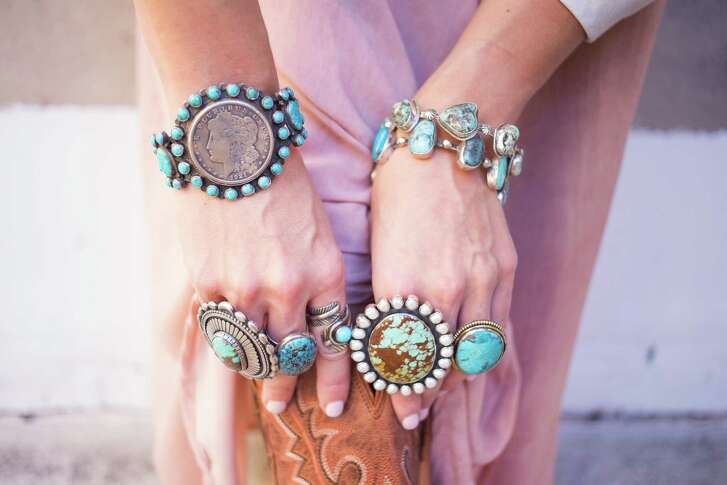 RODEO FASHION: J. Landa's Navajo turquoise & sterling silver Lady Liberty coin cuff, retail $400.  The two large rings are $600 each and the oval turquoise is $125, the more circular one is $125 (with thicker sterling silver surround on the model's left hand) and the one with a leaf-like wrap is $180. All from J. Landa, 2412 Rice Blvd.