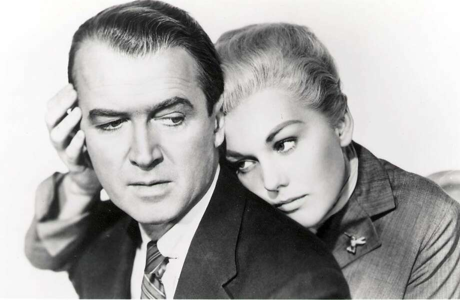 "James Stewart and Kim Novak in Hitchcock's classic 'Vertigo.' James Stewart is John ""Scottie"" Ferguson, a former police detective with an acute fear of heights who is hired by an old college pal to trail his mysterious wife (Kim Novak). (1997) Photo: Paramount 1958"