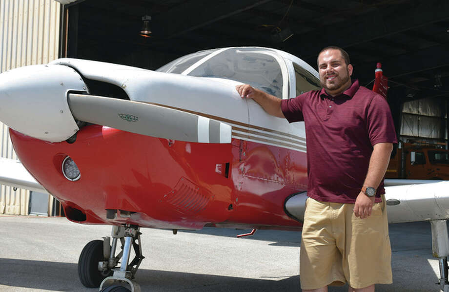 Jacksonville Municipal Airport's new flight instructor, Brandon Montrey, stands next to a Piper Archer single-engine plane at the airport. Photo: Greg Olson | Journal-Courier