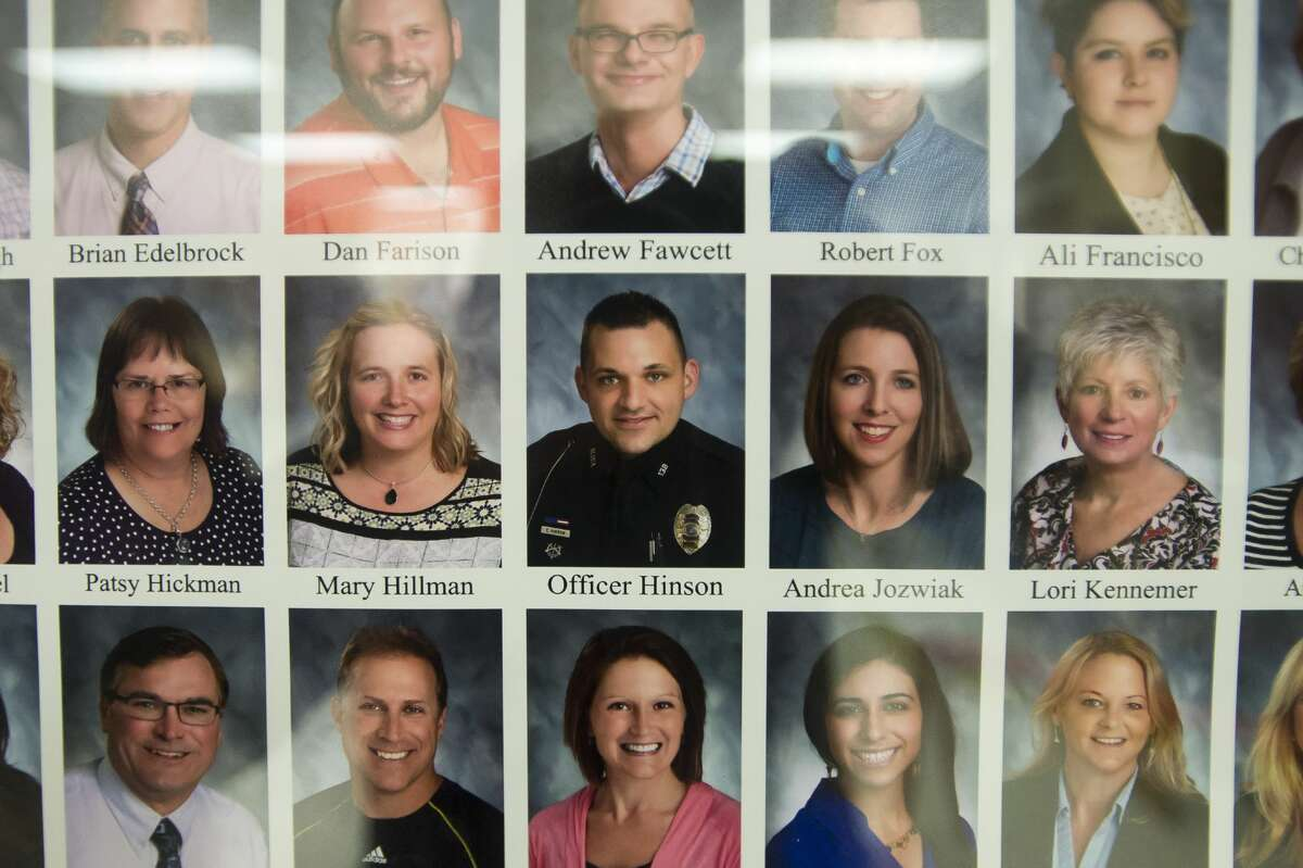Eddie Hinson, Midland High's new School Resource Officer, is featured on a staff poster inside the school on Tuesday, Feb. 6, 2018. (Katy Kildee/kkildee@mdn.net)
