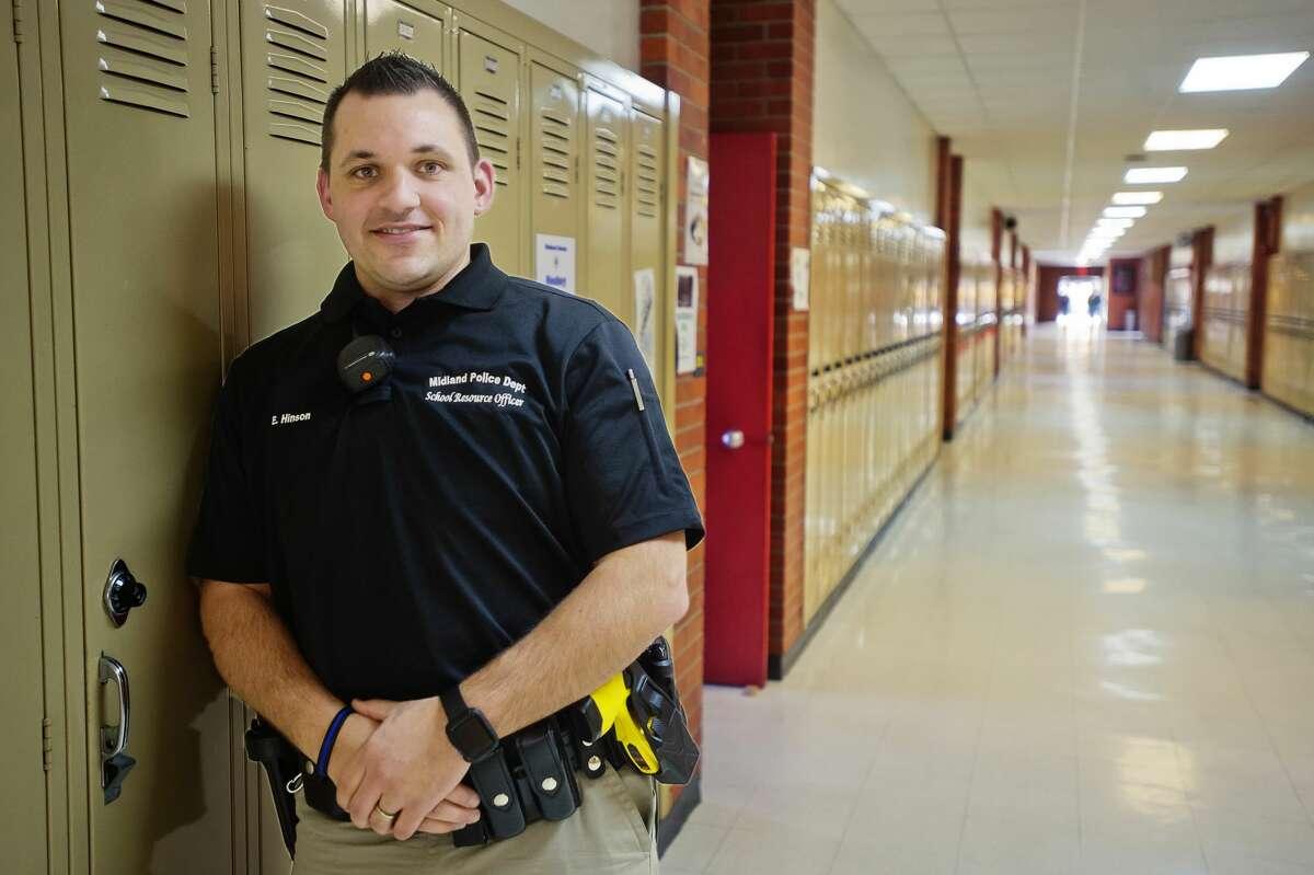 Eddie Hinson, Midland High's new School Resource Officer, poses for a portrait inside the school on Tuesday, Feb. 6, 2018. (Katy Kildee/kkildee@mdn.net)