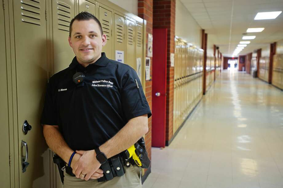 Eddie Hinson, Midland High's new School Resource Officer, poses for a portrait inside the school on Tuesday, Feb. 6, 2018. (Katy Kildee/kkildee@mdn.net) Photo: (Katy Kildee/kkildee@mdn.net)