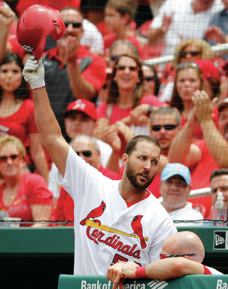 Cardinals pitcher Adam Wainwright tips his cap after hitting a two-run home run during the second inning to account for all the scoring in the Cards' 2-0 victory over the Los Angeles Dodgers on Thursday at Busch Stadium.