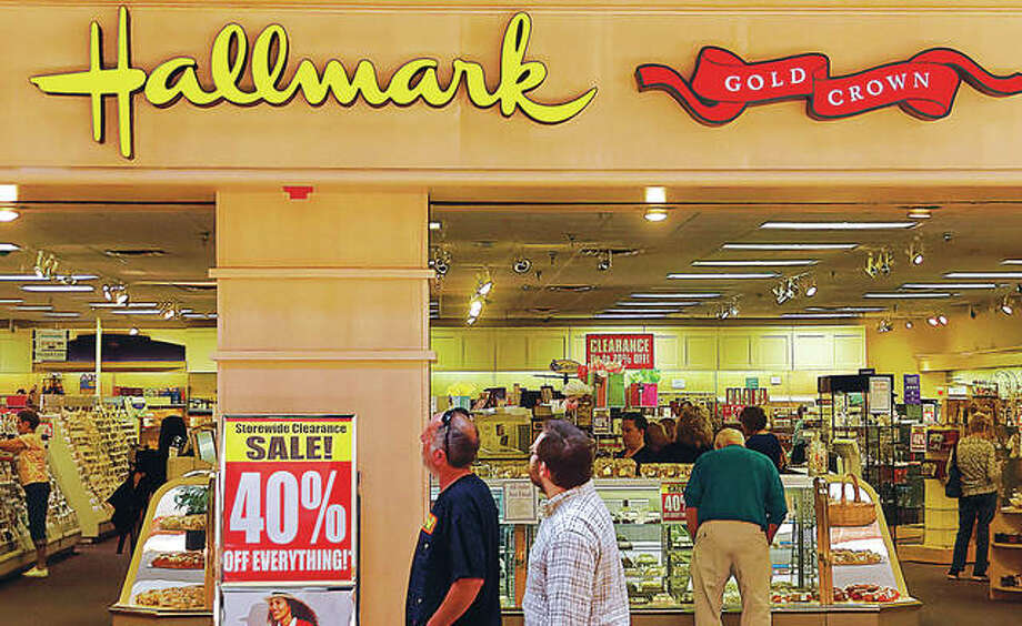Alton Square Mall shoppers pass by the Kirlin's Hallmark store Friday while shoppers peruse the gift shop for one of the final times. The store announced it will close following a liquidation sale. Employees told inquisitive customers that they weren't sure when the store would close for good. Kirlin's has closed several of its independently-owned Hallmark stores this year, including locations in Jacksonville, Quincy and Macomb. Photo: Nathan Woodside | For The Telegraph