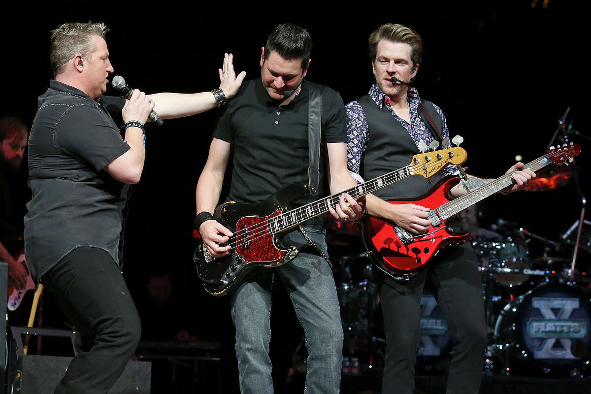 Rascal Flatts' Gary LeVox (from left), Jay DeMarcus, and Joe Don Rooney perform during the San Antonio Stock Show & Rodeo Monday Feb. 17, 2014 at the AT&T Center.