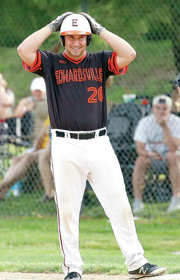 Edwardsville's Daniel Reed stands on first base after hitting a two-run single in the sixth inning of the Tigers' win over O'Fallon the sectional semifinals Photo: Scott Kane | For The Telegraph