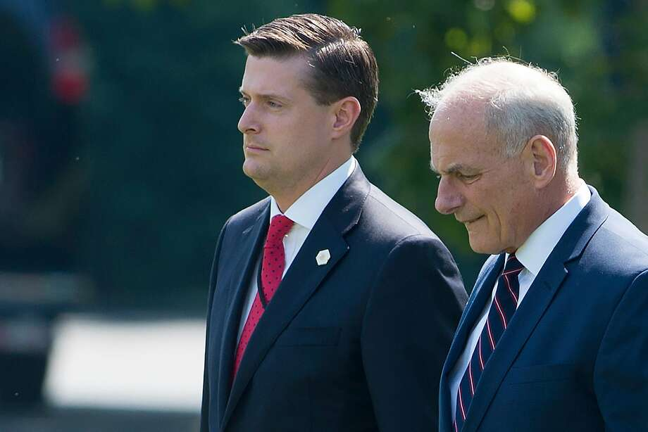 (FILES) White House Chief of Staff John Kelly (R) and White House Staff Secretary Rob Porter (L)walk to Marine One prior to departure from the South Lawn of the White House in Washington, DC, August 4, 2017.  Photo: SAUL LOEB, AFP/Getty Images