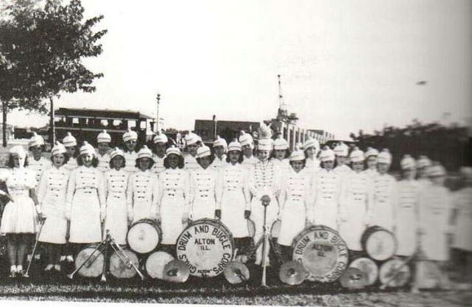 The Alton Girls Drum and Bugle Corps was an award-winning drill team that performed at many special events in the midwest. Posed here in Riverside Park in 1939, they were about to leave on another trip. The drum and bugle team tradition was carried on throughout the fifties and sixties by the Piasa Indians Drum and Bugle Corps. Alton was the scene of major drum and bugle competitions for several years, organized by the late Don Plarski.