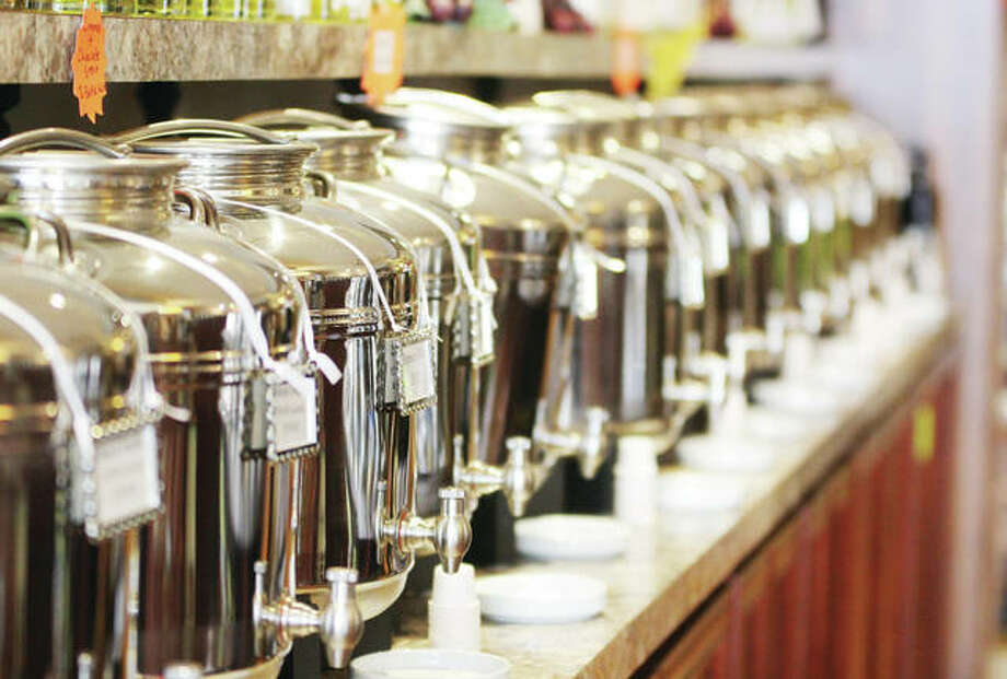 The Olive Oil Marketplace carries about 80 flavors of olive oils and vinegars, which can be sampled for free. Photo: Scott Cousins/The Telegraph