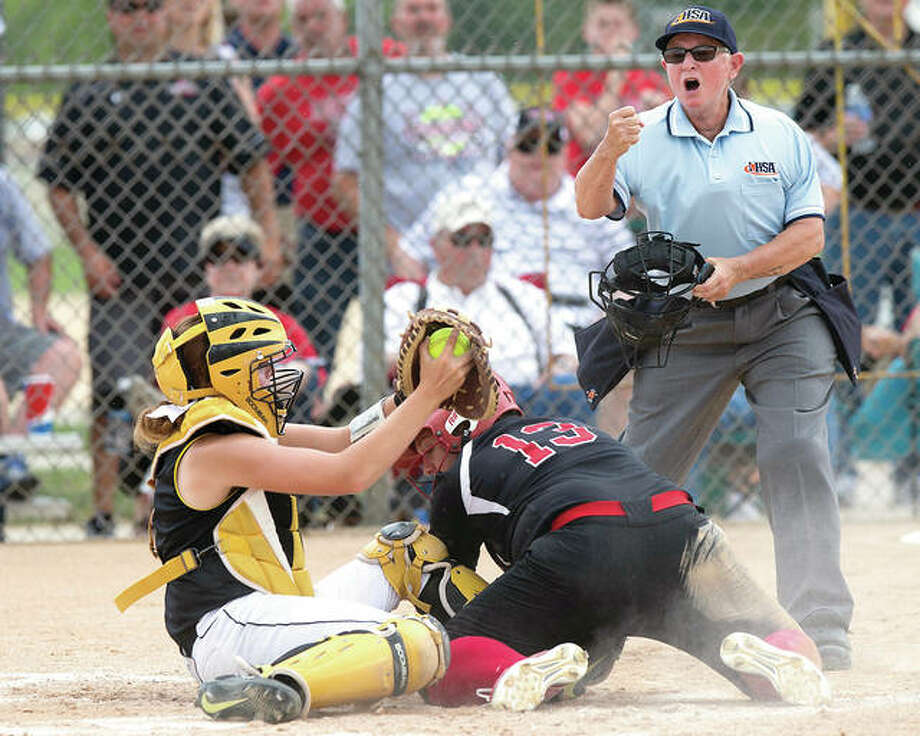 Goreville catcher Summar Albright, left, shows the ball to umpire Cori Smith, who calls out Calhoun's Kyleigh Presley (13) during the Class 1A state softball championship game Saturday in East Peoria. The Blackcats defeated the Warriors 2-0 in extra innings to win the championship. Photo: Douglas Cottle, PhotoNews Media | For The Telegraph