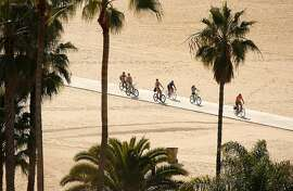 People enjoy the beach in Santa Monica Monday morning, Jan. 29, 2018 as temperatures approached daily high temperature records. (Al Seib/Los Angeles Times/TNS)
