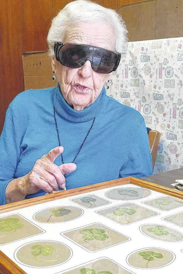 Frances Rubash, 94, of Woodson has framed 20 of the 56 four- and five-leaf clovers she found in her yard.