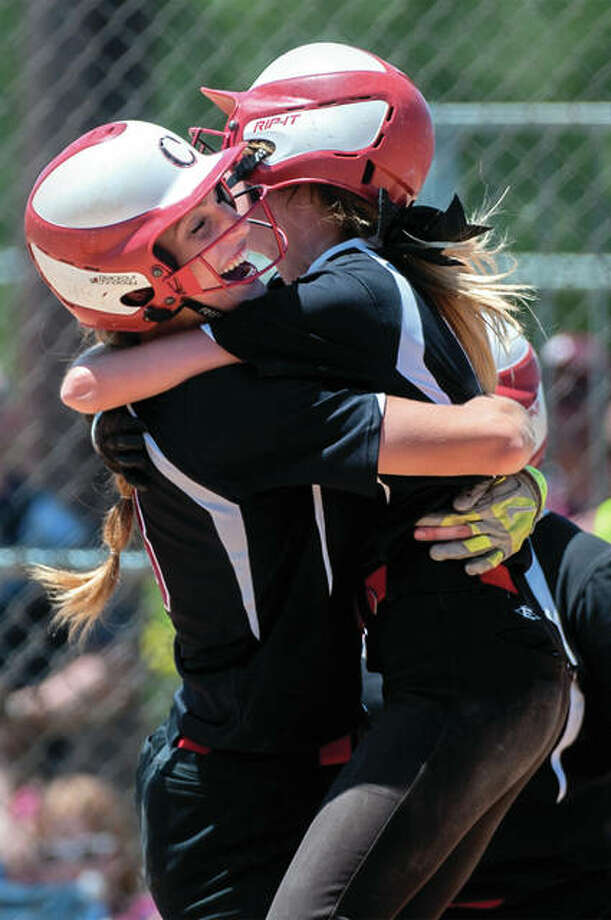 Calhoun's Grace Baalman (left) and Junie Zirkelbach celebrate after Zirkeback scored the winning run in the 12th inning to give the Warriors a 2-1 victory over Princeville in the Class 1A softball state semifinals on Friday at EastSide Centre in East Peoria. Photo: Matt Dayhoff / Peoria Journal Star