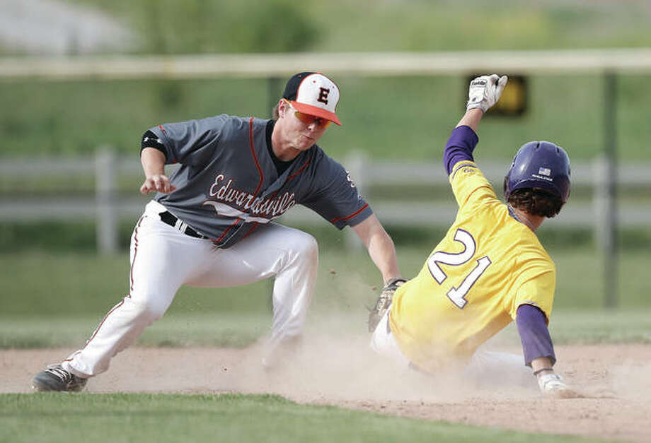 Edwardsville second baseman Joel Quirin (left) tags out Civic Memorial's Konnar Loewen on a stolen base attempt during a Tigers win May 15 at the Bethalto Sports Complex. Both the Tigers and Eagles played for sectional titles on Saturday, with Edwardsville defeating Normal West 7-0 and CM falling to Mascoutah 5-4. Photo: Billy Hurst / For The Telegraph