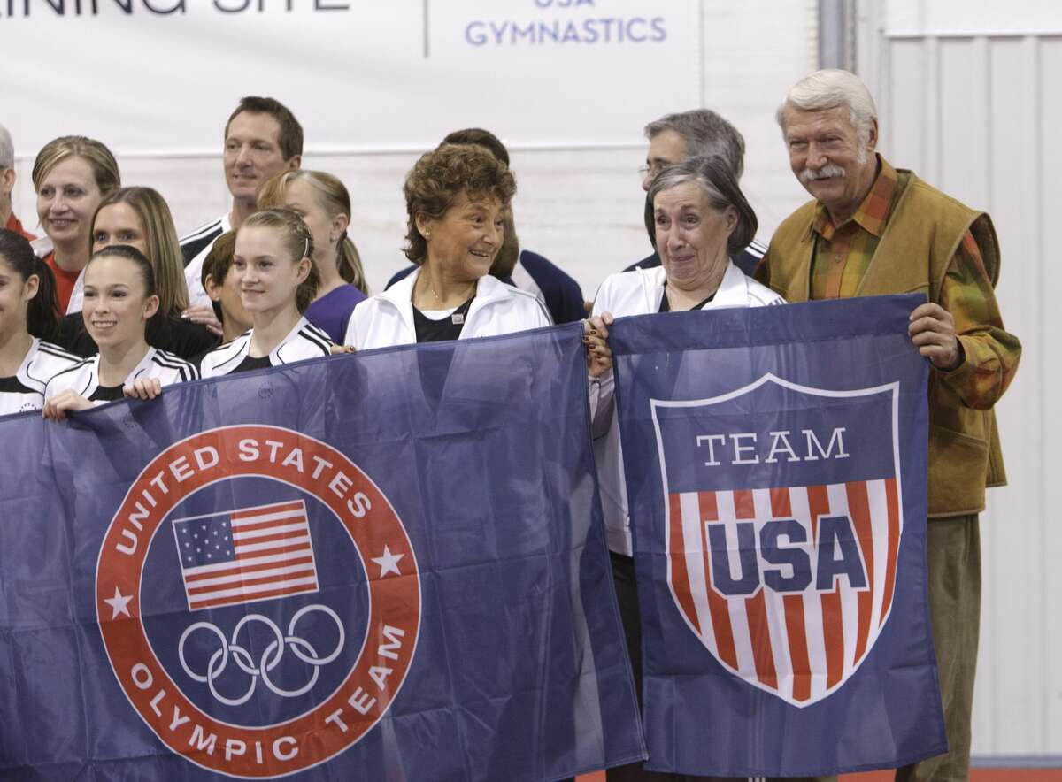 HUNTSVILLE, TX - JANUARY 26: Martha & Bela Karolyi as well as J. Turner, Jeff Diskin with gymnasts display banners for their facility as Karolyi Ranch was named an official training site for USA Gymnastics on January 26, 2011 in Huntsville, Texas. (Photo by Bob Levey/Getty Images for Hilton)
