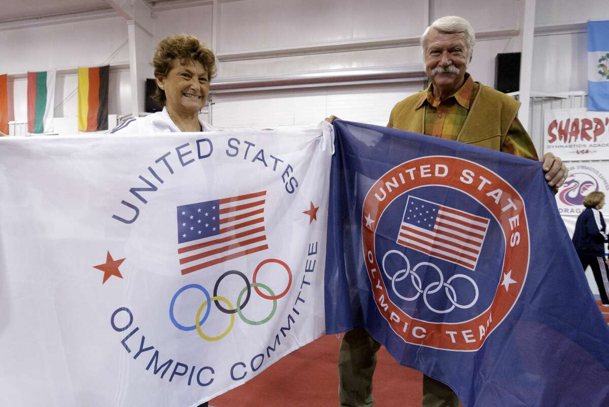 HUNTSVILLE, TX - JANUARY 26: Martha & Bela Karolyi display banners for their facility as Karolyi Ranch was named an official training site for USA Gymnastics on January 26, 2011 in Huntsville, Texas. (Photo by Bob Levey/Getty Images for Hilton)