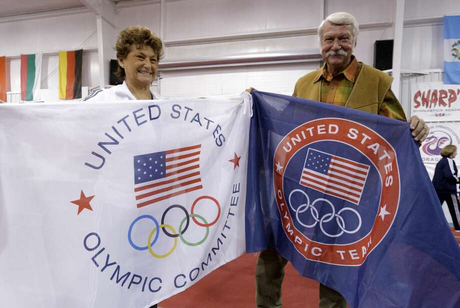 HUNTSVILLE, TX - JANUARY 26:  Martha & Bela Karolyi display banners for their facility as Karolyi Ranch was named an official training site for USA Gymnastics on January 26, 2011 in Huntsville, Texas.  (Photo by Bob Levey/Getty Images for Hilton) Photo: Bob Levey