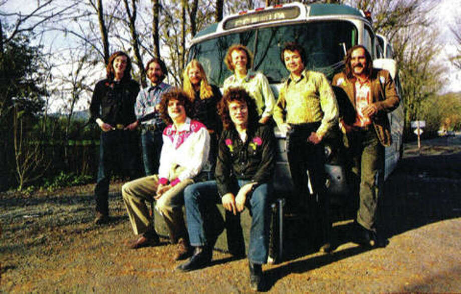 "Commander Cody and his Lost Planet Airmen, with their Greyhound Scenicruiser tour bus ""Honeysuckle Rose,"" circa 1973. This is the back of the band's second album that year. Photo: Submitted/For The Telegraph"