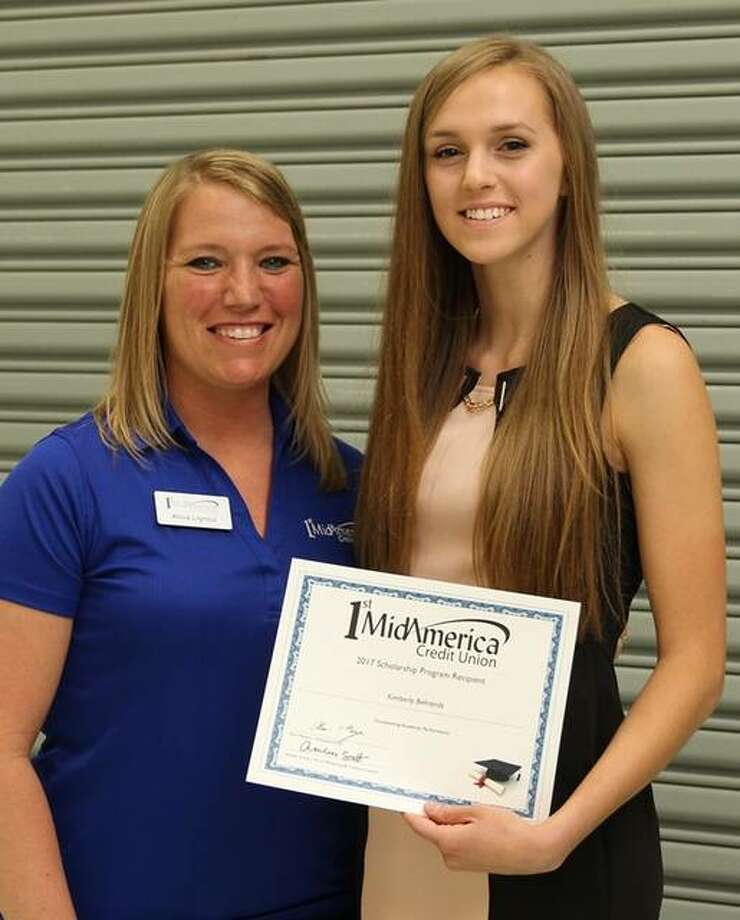 Alicia Lignoul, 1st MidAmerica Credit Union community relations coordinator, presents a $1,000 scholarship to Kimberly Behrends of Southwestern High School. Photo: For The Telegraph