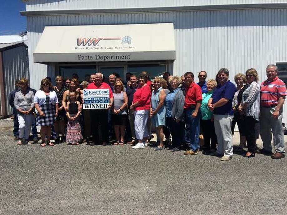 Alex Heeb/The Telegraph Dwight Werts, president and CEO of Werts Welding and Tank Service Inc., stands with employees and RiverBend Growth Association (RBGA) dignitaries, who designated Wood River-based Werts Welding and Tank Service as RBGA Small Business of the Month for June.