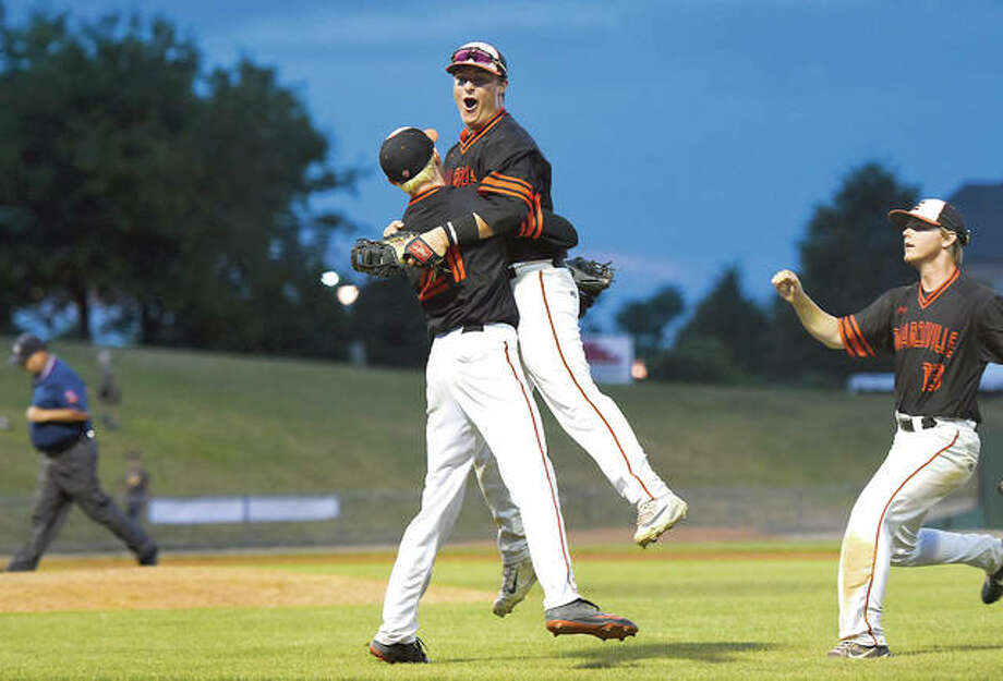 Edwardsville's Drake Westcott jumps into the arms of pitcher Andrew Yancik after defeating Burbank St. Laurence in the IHSA Class 4A state semifinals Friday in Joliet. Photo: Gary Middendorf | For The Telegraph