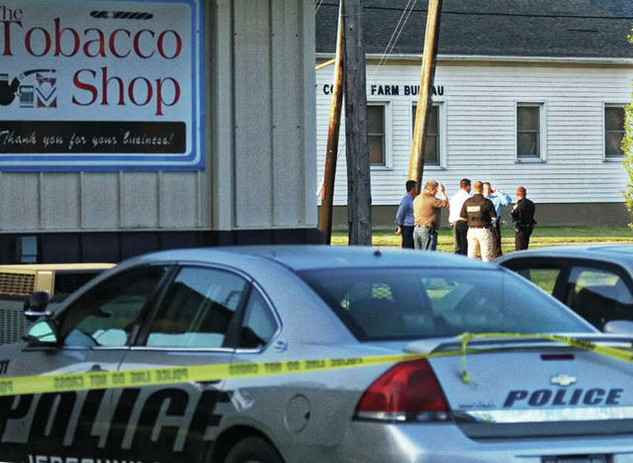 A Jerseyville police vehicle, possibly that of the officer wounded by gunfire in an early morning incident that left a burglary suspect dead, is roped off by police tape at The Tobacco Shop, 303 S. Jefferson St. Photo: Nathan Woodside | For The Telegraph