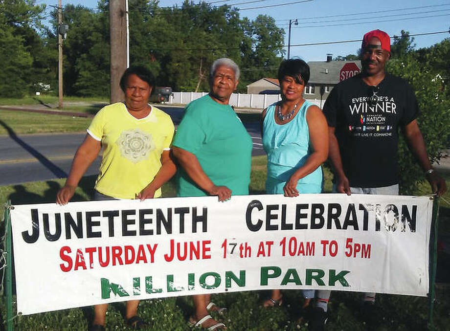 Members of the Juneteenth Celebration committee, from left, Carolyn Thompson, Anne Johnson, Marquato Rattler and Abe Barham display this year's banner at James Killion Park. Photo: Submitted Photo/For The Telegraph