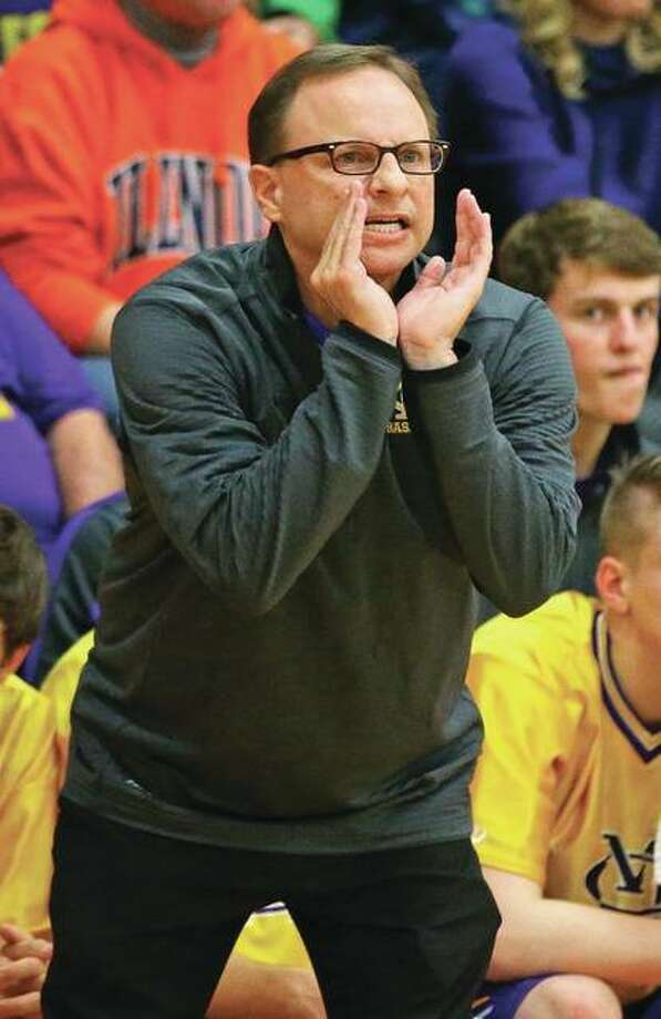 Civic Memorial's coach Doug Carey shouts instructions from the bench during a boys basketball game Dec. 18 in Roxana. Carey has resigned as CM coach after five seasons. Photo: Billy Hurst / For The Telegraph