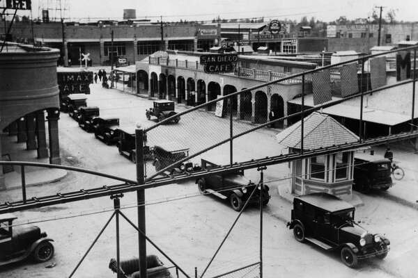 The Mexicali border station (pictured below in 1929) was surrounded by a tall fence. Cars lined up to cross into California.