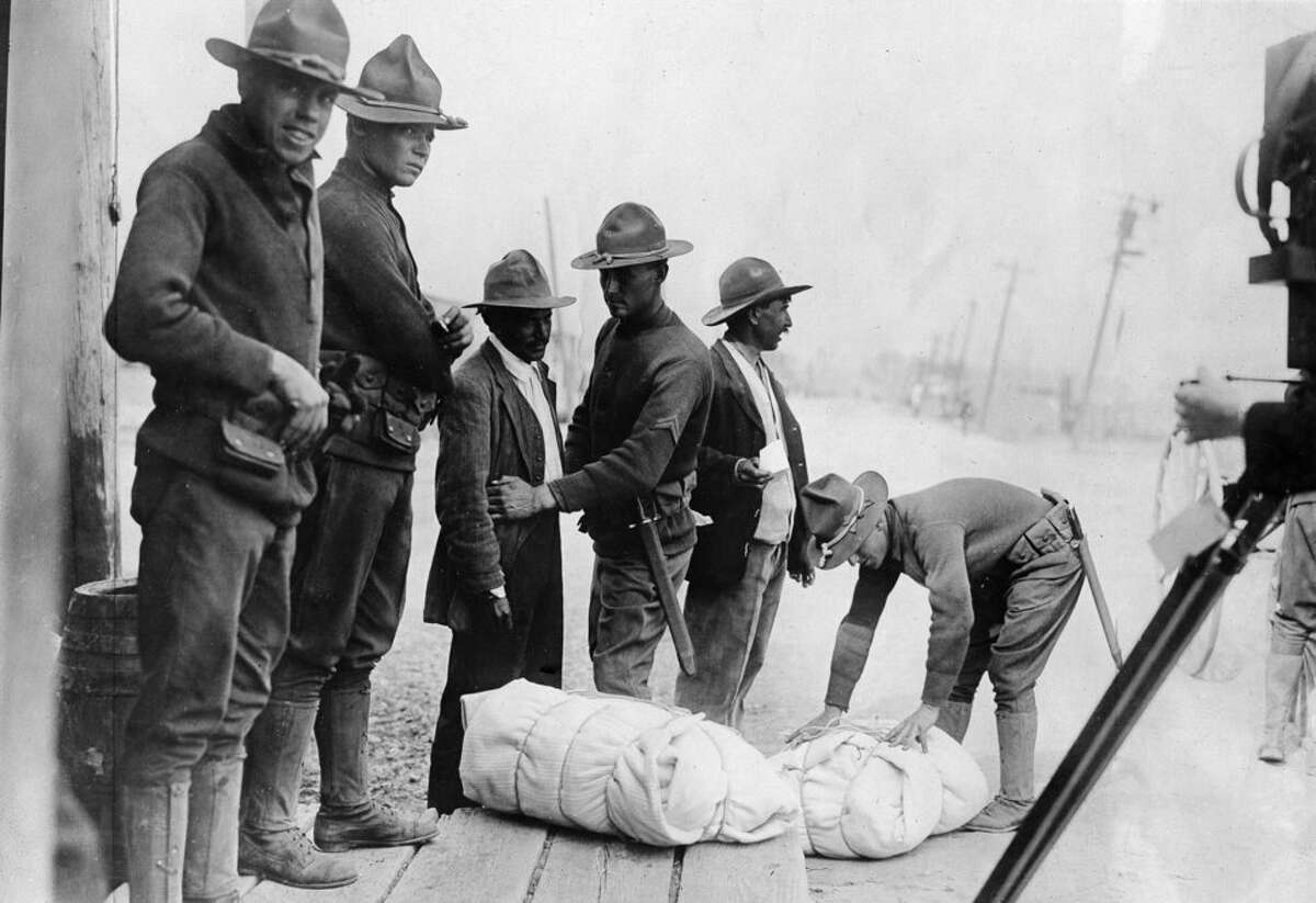 The U.S. established an official border patrol in 1924 with the goal of securing the U.S.-Mexico border. In the photo below, American guards pat down Mexicans who wish to enter the U.S.