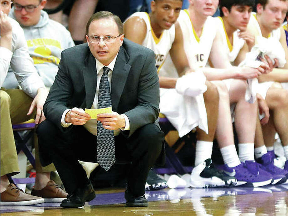 Doug Carey has stepped down as head coach of the Civic Memorial boys basketball team after five seasons. He is pictured during a game against Highland last season. Photo: Billy Hurst | For The Telegraph