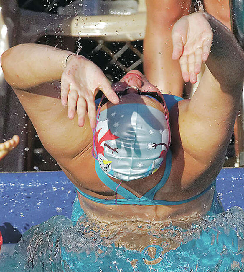 Summers Port senior swimmer Shelby Roth starts the medley relay with the backstroke Thursday in SWISA action at Waterworks pool in Edwardsville. Photo: Nathan Woodside | For The Telegraph