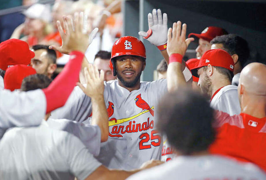 The Cardinals' Dexter Fowler high-fives as he celebrates in the dugout after hitting a solo home run in the sixth inning of Friday night's 11-2 win over the Orioles in Baltimore,. Photo: AP