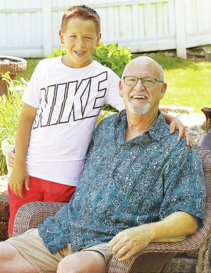 Former Alton and Godfrey fire chief John Sowders with his son, Logan, 10, at their Godfrey home. Photo: John Badman | The Telegraph