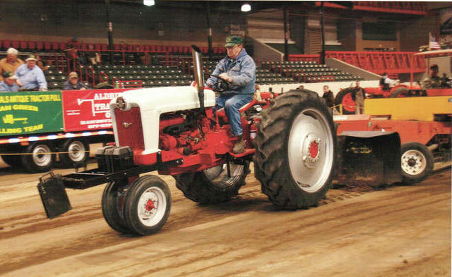 "Walter ""Sonny"" Crafton, 80, of Shipman, has pulled in eight states and 33 different pulling locations. Truck and tractor pulling is a motorsport competition, which requires modified tractors to pull a heavy sled along a typically 35-foot-wide, 330-foot-long track, with the winner being the tractor that pulls the sled the farthest. Photo: Photo Courtesy Of Walter Crafton/For The Telegraph"
