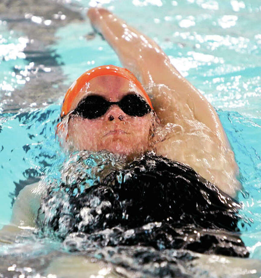 Elizaebth McPherson swims the backstroke during her days at Edwardsville High School. Coming off her freshman season as a swimmer at Illinois State University, she is also serving as coach this summer of the Waterworks Marlins SWISA swim team. Photo: Telegraph File Photo