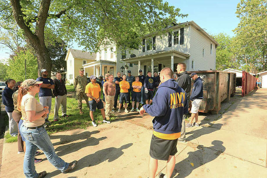 Sailors from Navy Recruiting District St. Louis receive a safety brief prior to conducting a Habitat for Humanity project. Sailors helped reconstruct a home during the volunteer event as part of CPO 365 training. CPO 365 is a year-long program designed to ensure the CPO Mess and first class petty officers are continually and steadily developing to succeed in future leadership positions and affords the opportunity for education and training. Photo: Norm Langhoff | For The Telegraph