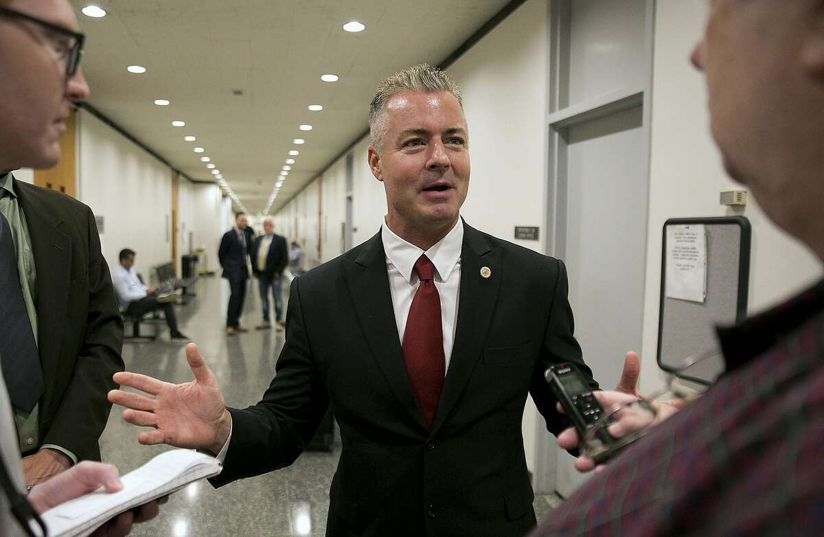 FILE - In this Sept. 22, 2017 file photo, Republican gubernatorial candidate Assemblyman Travis Allen, R-Huntington Beach, discusses a judge's ruling in Sacramento, Calif. Documents released Friday, Feb. 2, 2018, by the California Legislature show four current lawmakers faced sexual misconduct complaints since 2006. The documents outline complaints against Democratic Assemblywoman Autumn Burke of Los Angeles, Republican Assemblyman Travis Allen of Huntington Beach, Democratic Sen. Tony Mendoza of Artesia and Democratic Sen. Bob Hertzberg of Van Nuys. (AP Photo/Rich Pedroncelli, File)