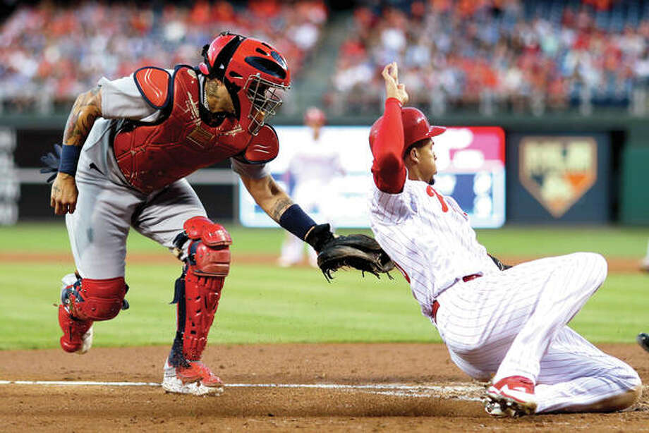 Cardinals catcher Yadier Molina, left, tags out Philadelphia's Aaron Altherr at home as Altherr tried to score on a single by Tommy Joseph in the fourth inning of Wednesday's game in Philadelphia. Photo: AP