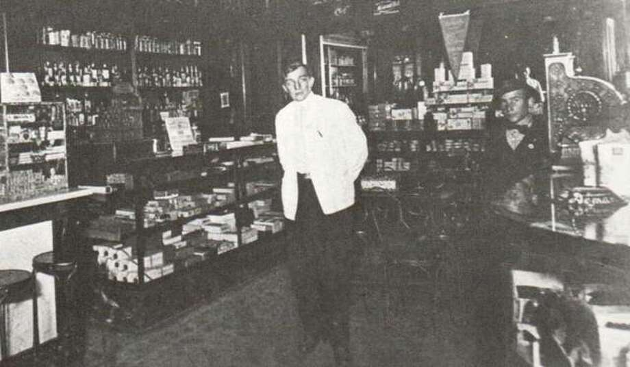 When the Sanders Drug Store at the Broadway and Market Street intersection was remodeled, the proud owners pictured the improvements on a postal card. The building housed drug stores for most of the years of its existence. While Mrs. Sanders presided over the preparation of the many meals served in the drug store, young Henry Hillebrecht was in charge in the back of the store. High ceilings permitted the display of many shelves full of goods. Elaborate stained-glass doors covered the cabinets located at the top. Photo: File Photo