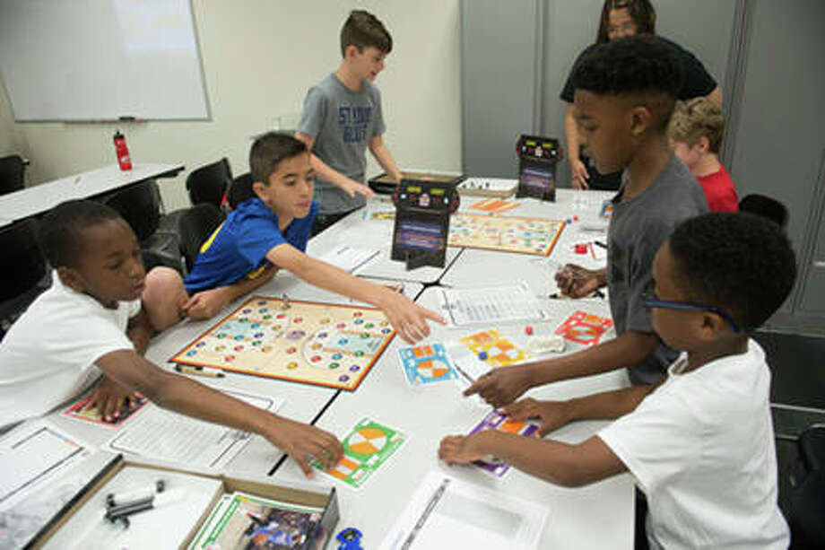 Participants in SIUE's We Got Game: NBA Math Hoops camp work together to enhance their math skills through interactive learning. Photo: For The Telegraph