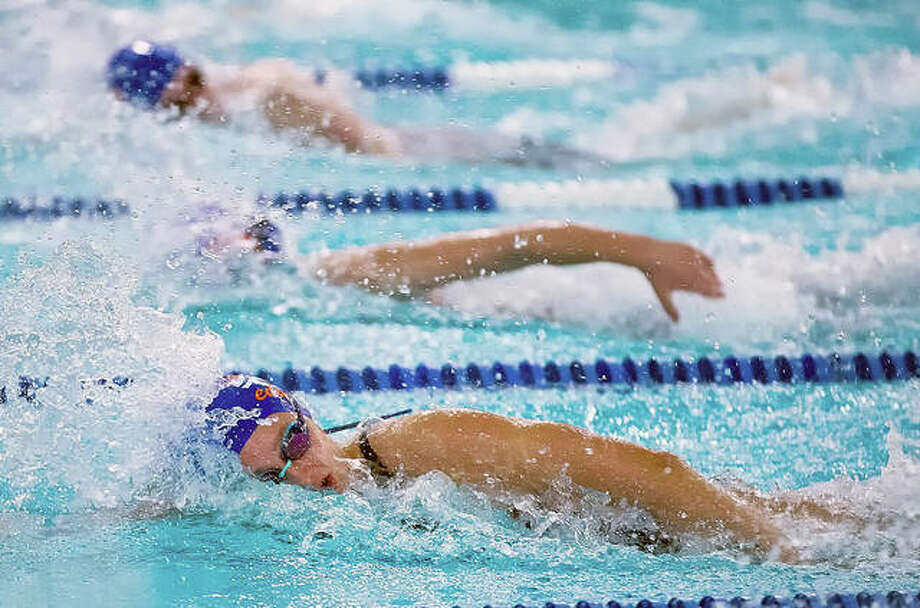 Bailey Grinter of Waterworks, front, won the 15-18 girls 200 freestyle in 2:15.66, the 100 freestyle in 1:03.06 and the 50 freestyle in 28.53 seconds at Thursday's SWISA meet in Edwardsville against Splash City of Collinsville.